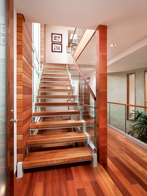 Mid-sized contemporary wooden straight open and glass railing staircase  idea in Los Angeles