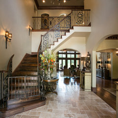 mediterranean staircase by Terry M. Elston, Builder