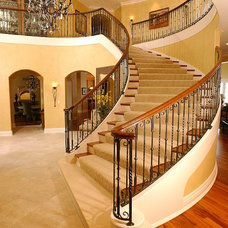 Traditional Staircase by Iron Creations USA LTD