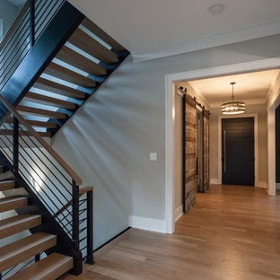 Inspiration for a contemporary wooden u-shaped open and mixed material railing staircase remodel in DC Metro