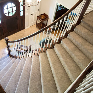 Example of a mid-sized classic carpeted curved staircase design in Kansas City with carpeted risers