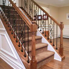 Traditional Staircase by Creative Design Construction, Inc.