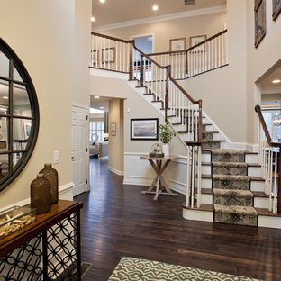 Example of a classic wooden curved staircase design in Boston