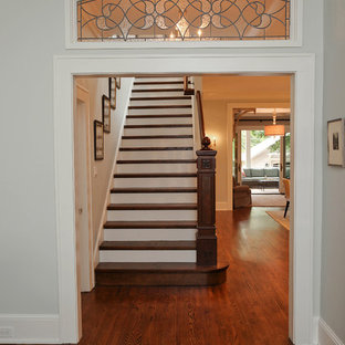 Example of a mid-sized classic wooden straight staircase design in Charlotte with painted risers