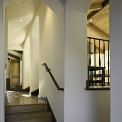 mediterranean staircase by Claudio Ortiz Design Group, Inc.