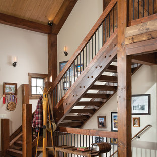 Inspiration for a rustic wooden l-shaped open and mixed material railing staircase remodel in Denver