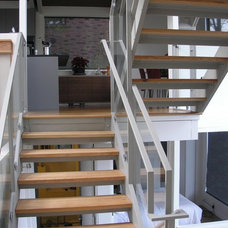 Modern Staircase by Building Arts Workshop