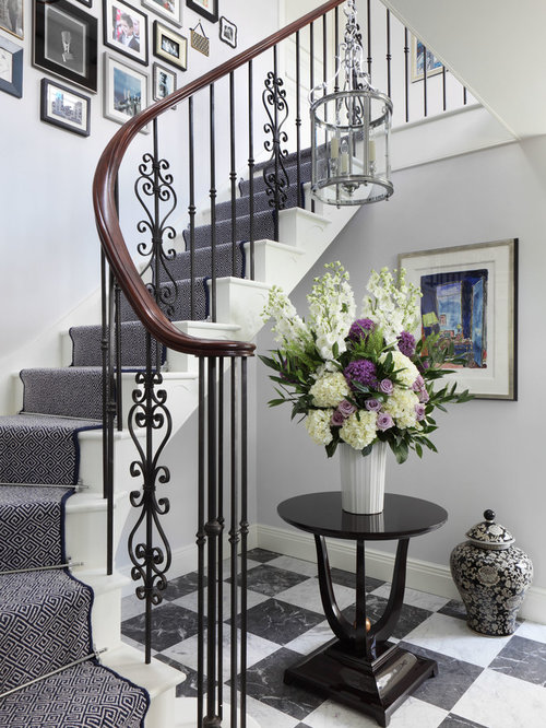 Mid-sized elegant painted curved staircase photo in London