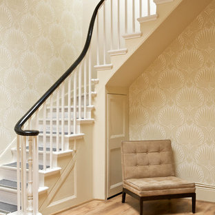 Staircase - traditional painted l-shaped staircase idea in Dorset with painted risers