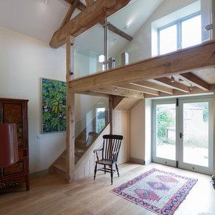 Foto de escalera en L, campestre, pequeña, con escalones de madera y contrahuellas de madera