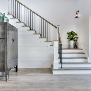 Country concrete staircase in Orange County with painted wood risers.