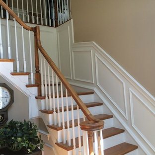 Inspiration for a mid-sized timeless wooden l-shaped staircase remodel in DC Metro with painted risers