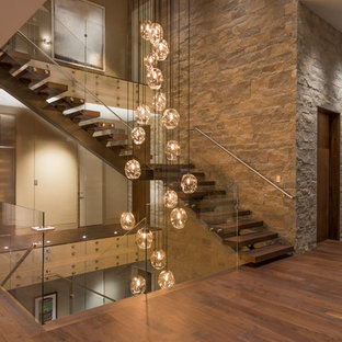Inspiration for a contemporary wooden l-shaped open and glass railing staircase remodel in Orange County