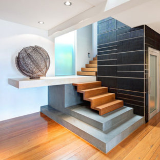 Large contemporary wood l-shaped staircase in Sydney with wood risers.