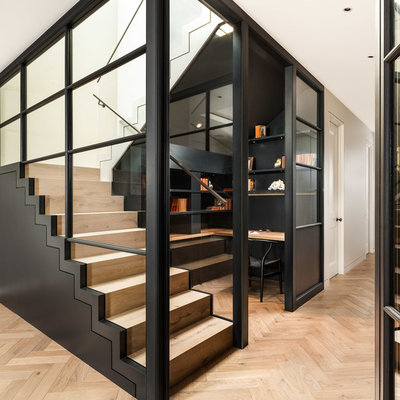 Staircase - contemporary wooden u-shaped staircase idea in London with wooden risers
