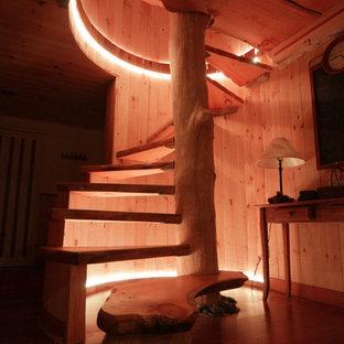 Esempio di una scala a rampa dritta rustica di medie dimensioni con pedata in legno, nessuna alzata e parapetto in legno