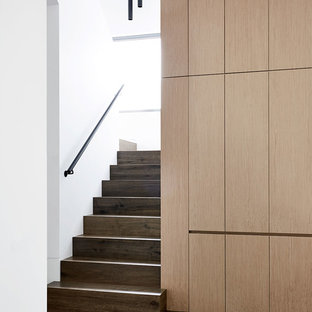 Photo of a contemporary wood u-shaped staircase in Melbourne.