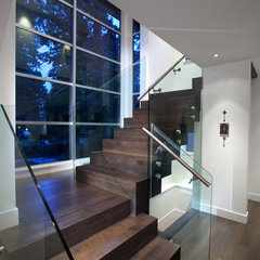 modern staircase by Meister Construction Ltd