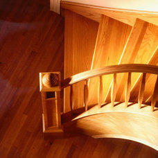 Contemporary Staircase by Master Woodworks inc