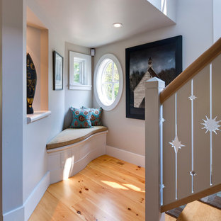 Example of a mid-sized trendy wooden l-shaped wood railing staircase design in Boston with painted risers