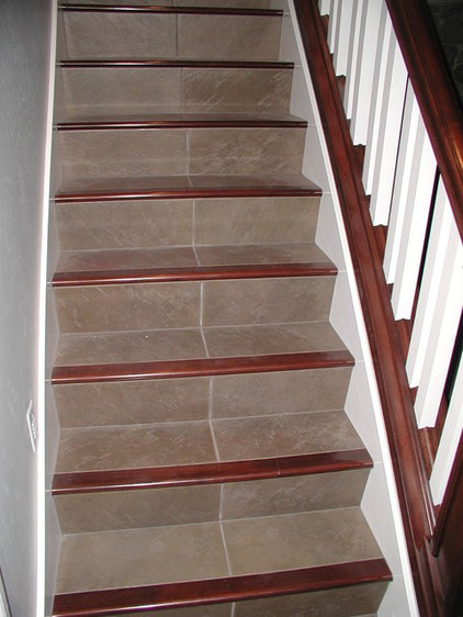 Traditional Staircase by Markim Construction, LLC