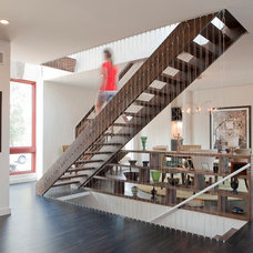 Contemporary Staircase by Urban Improvement Company