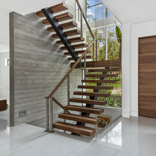 Trendy wooden floating open and cable railing staircase photo in Orlando