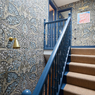 Inspiration for a traditional carpeted wood railing staircase in London with carpeted risers.