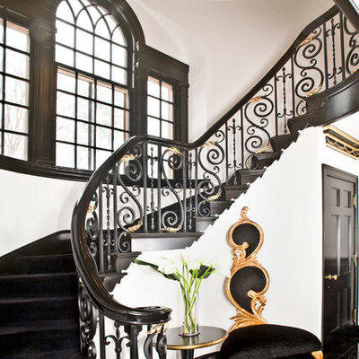 Inspiration for a large eclectic wooden curved mixed material railing staircase remodel in Cleveland with wooden risers