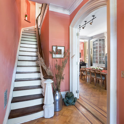 Staircase - small traditional wooden curved wood railing staircase idea in New York with painted risers