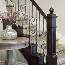 Traditional Staircase by Millennium Cabinetry
