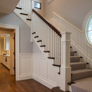 Design ideas for a medium sized victorian wood u-shaped wood railing staircase in Boston with painted wood risers.