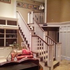 Traditional Staircase by Altitude Construction Services, LLC