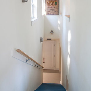 Mid-sized 1950s painted straight staircase photo in Miami with painted risers