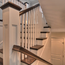 Traditional Staircase by LuAnn Development, Inc.
