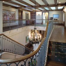 Mediterranean Staircase by E. B. Mahoney Builders, Inc.