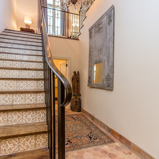 Design ideas for a large mediterranean wood u-shaped staircase in Houston with tiled risers.