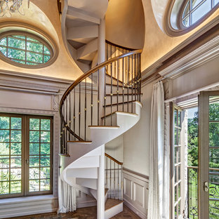 Elegant wooden spiral staircase photo in New York with wooden risers