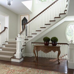 Front Entry and Main Staircase with spiral balusters and oval window