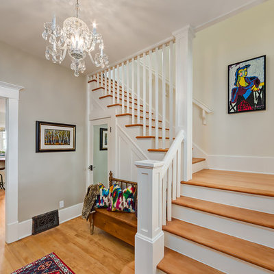 Mid-sized elegant wooden l-shaped staircase photo in Calgary with painted risers