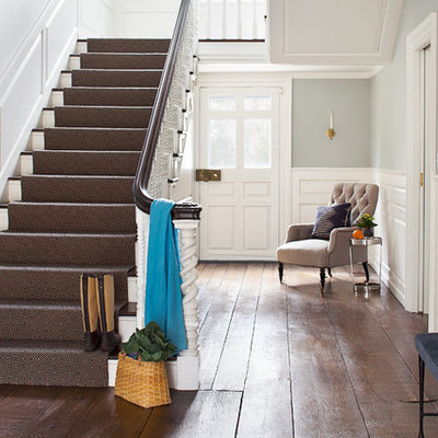Staircase - traditional wooden u-shaped staircase idea in New York