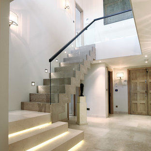 Design ideas for a contemporary wood l-shaped staircase in London with wood risers.