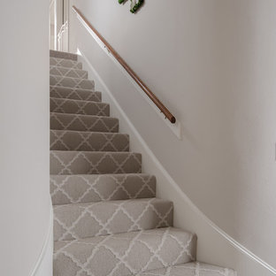 Staircase - large transitional carpeted straight wood railing staircase idea in Houston with carpeted risers