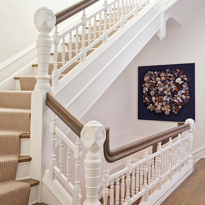 Inspiration for a large transitional wooden l-shaped staircase remodel in Chicago with painted risers