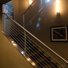 Modern Staircase by Christopher Lee & Company Fine Homes
