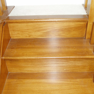 Mid-sized elegant wooden curved wood railing staircase photo in Cincinnati with wooden risers