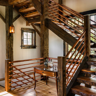 Staircase - rustic wooden open staircase idea in New York