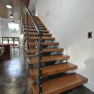 Example of a mid-sized minimalist wooden straight open staircase design in Orange County