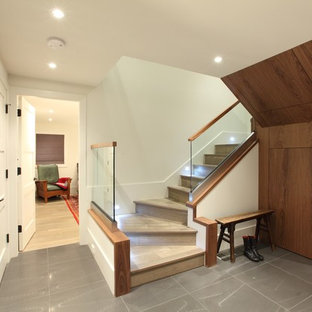 Trendy wooden staircase photo in Vancouver