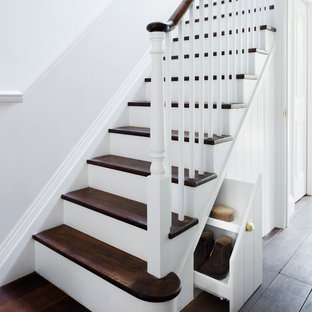 Medium sized victorian wood u-shaped staircase in London with painted wood risers.